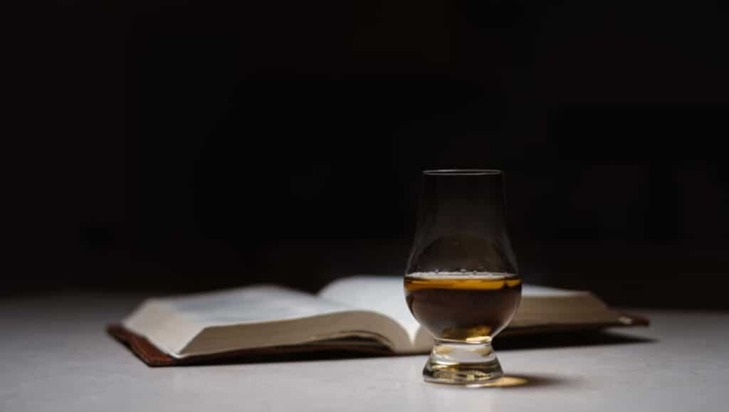Open book and whisky, photo Josh Applegate